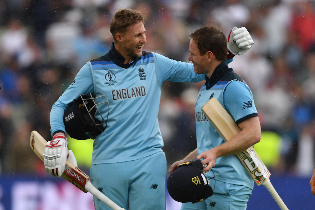 File: England's captain Eoin Morgan (R) and Joe Root celebrate victory after beating Australia by eight wickets.