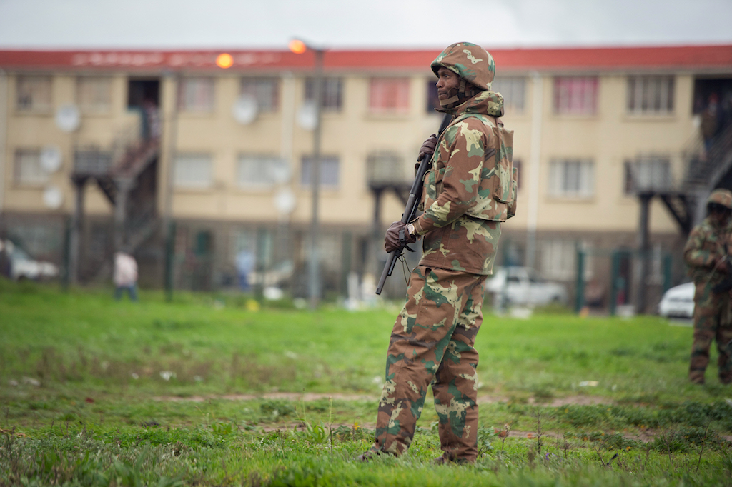 File: A member of the SANDF patrols a street in Hanover Park.