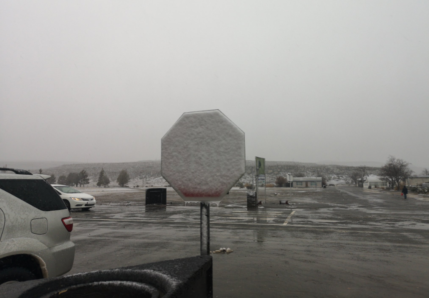 Snow covers a stop sign in Sutherland.