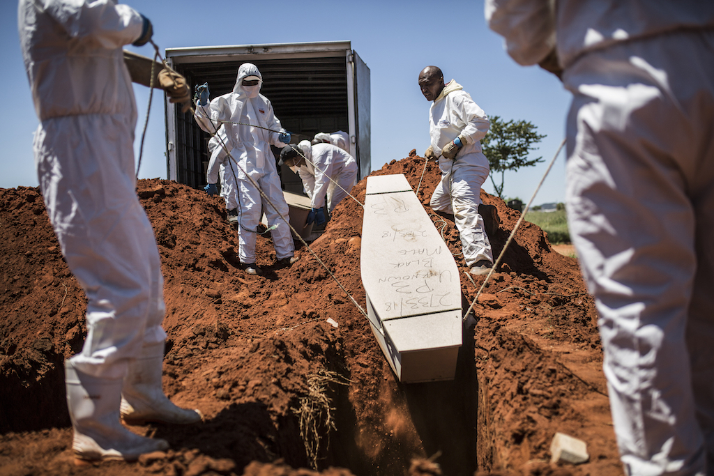 Morgue workers bury the coffin of an unidentified body at the Olifantsvlei Cemetery in Johannesburg.