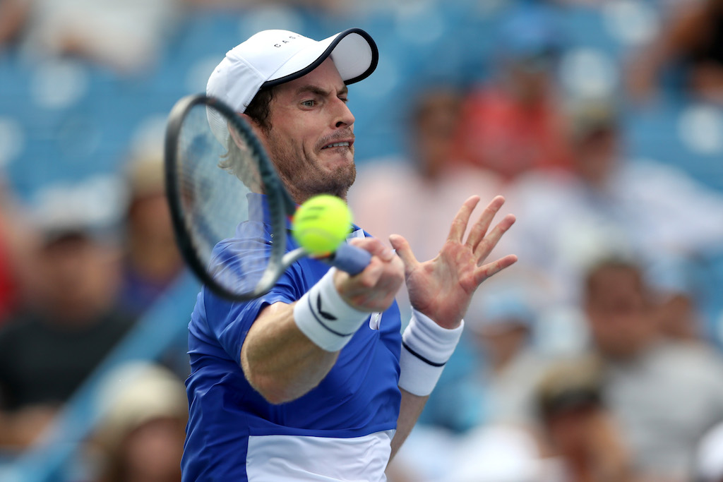 Andy Murray of Great Britain returns a shot to Richard Gasquet of France during Day 3 of the Western and Southern Open.