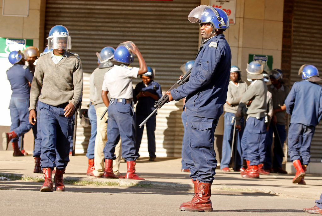 Riot police patrol the streets after police earlier banned planned protests by the opposition party Movement for Democratic Change (MDC) in Harare.