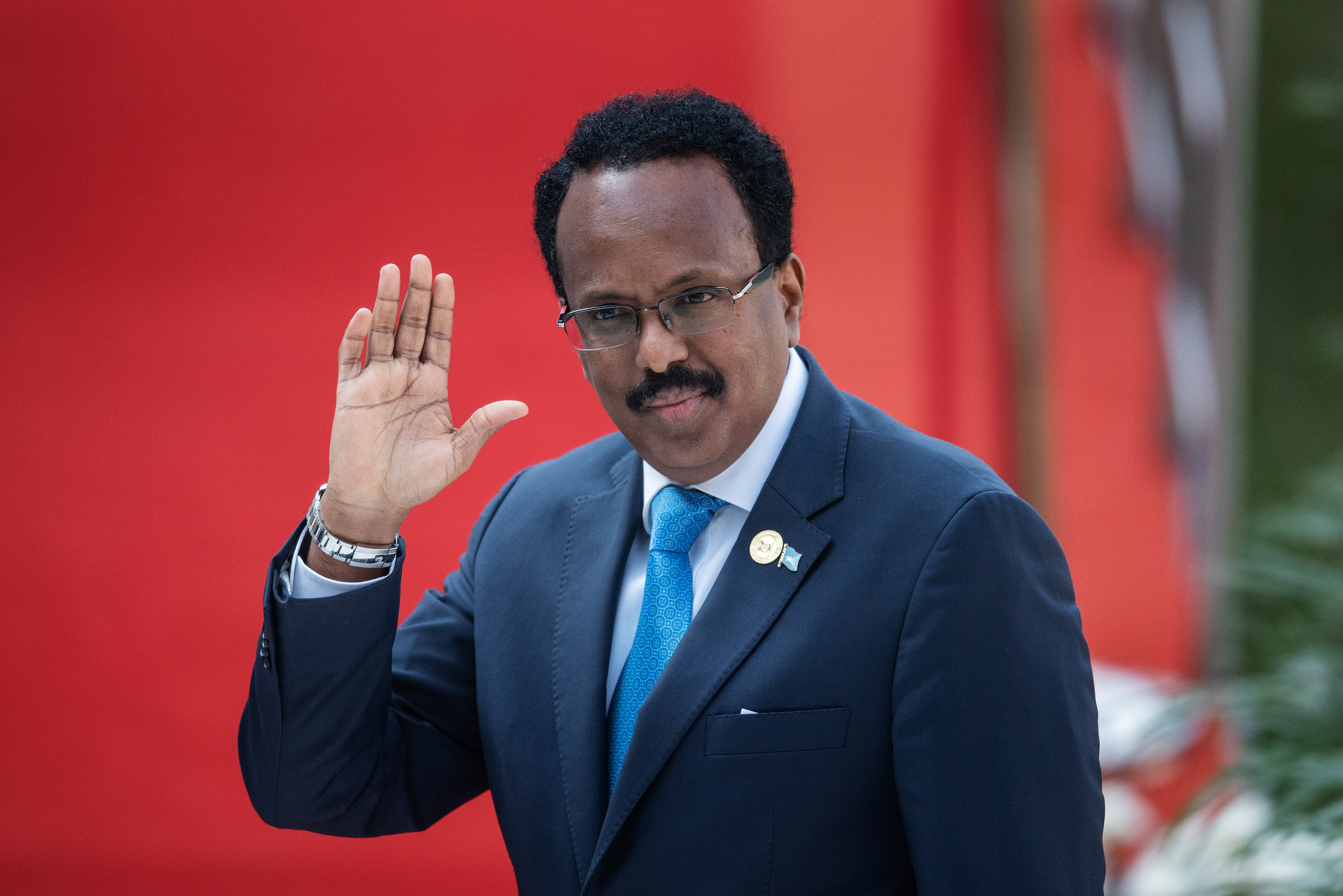 File: Somalia's President Mohamed Abdullahi Mohamed gestures while arriving at the Loftus Versfeld Stadium in Pretoria, South Africa, for the inauguration of Incumbent South African President Cyril Ramaphosa on May 25, 2019.