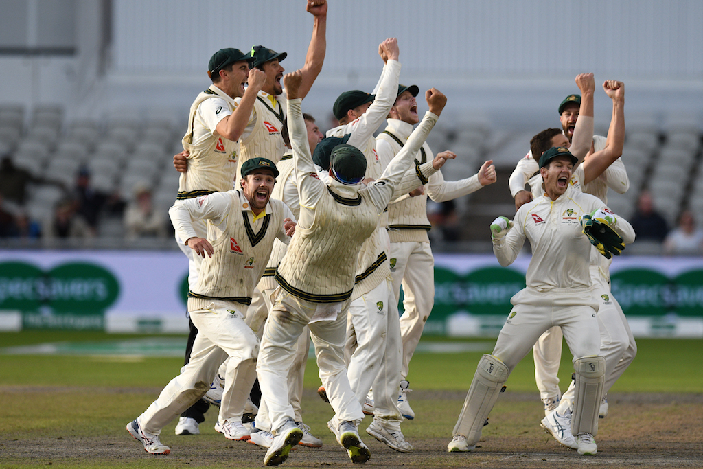 Australia's players celebrate their victory on the field on day five of the fourth Ashes cricket Test match at Old Trafford in Manchester, England on 8 September 2019.