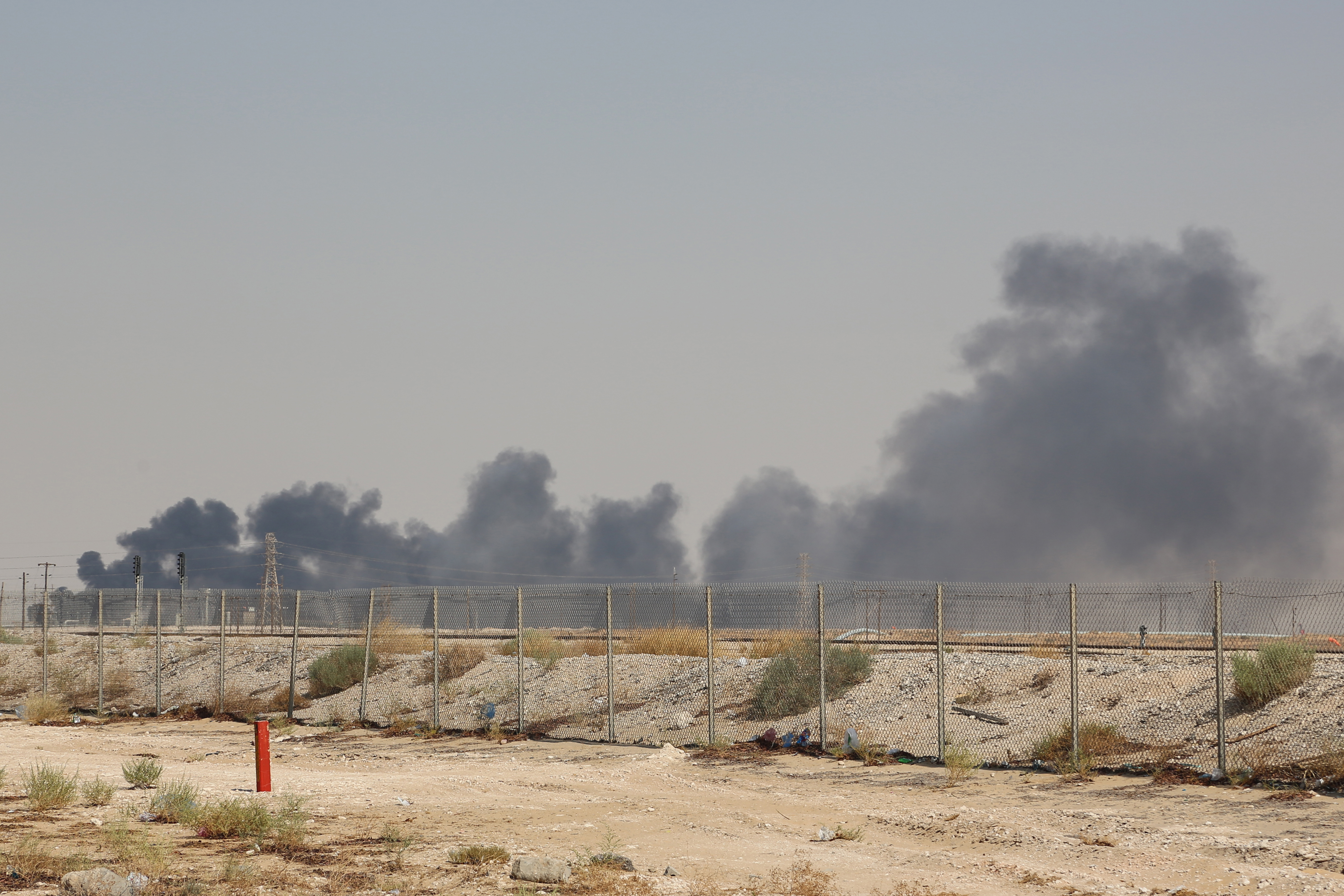 Smoke billows from an Aramco oil facility in Abqaiq about 60km (37 miles) southwest of Dhahran in Saudi Arabia's eastern province on September 14, 2019. Drone attacks sparked fires at two Saudi Aramco oil facilities on the day.