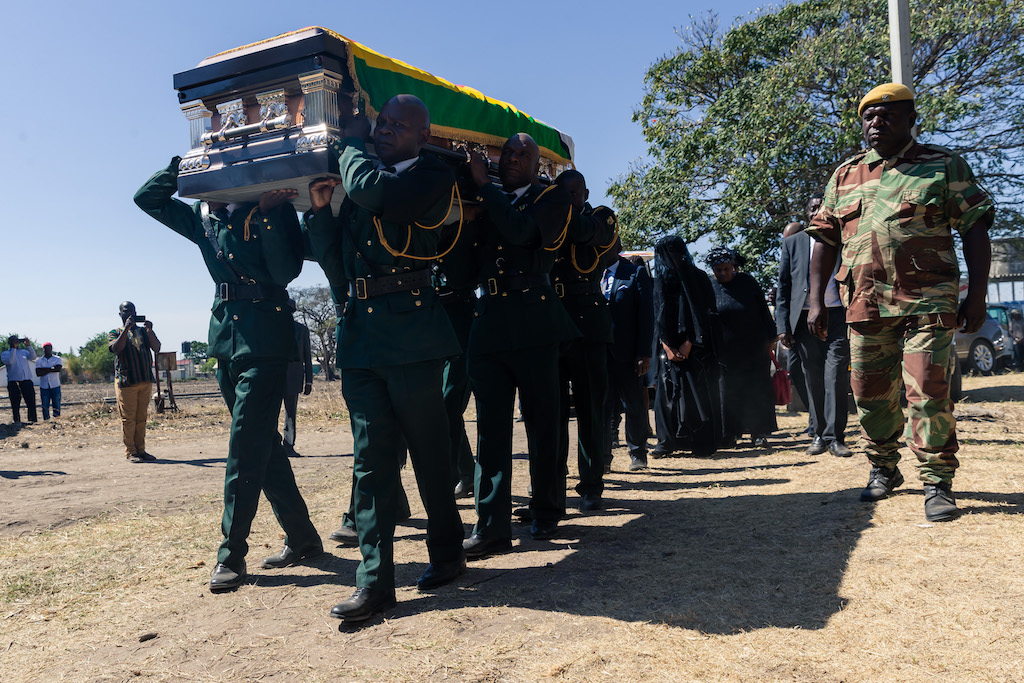 The coffin of former president of Zimbabwe Robert Mugabe arrives for his burial at his home village in Kutama, on 28 September 2019.