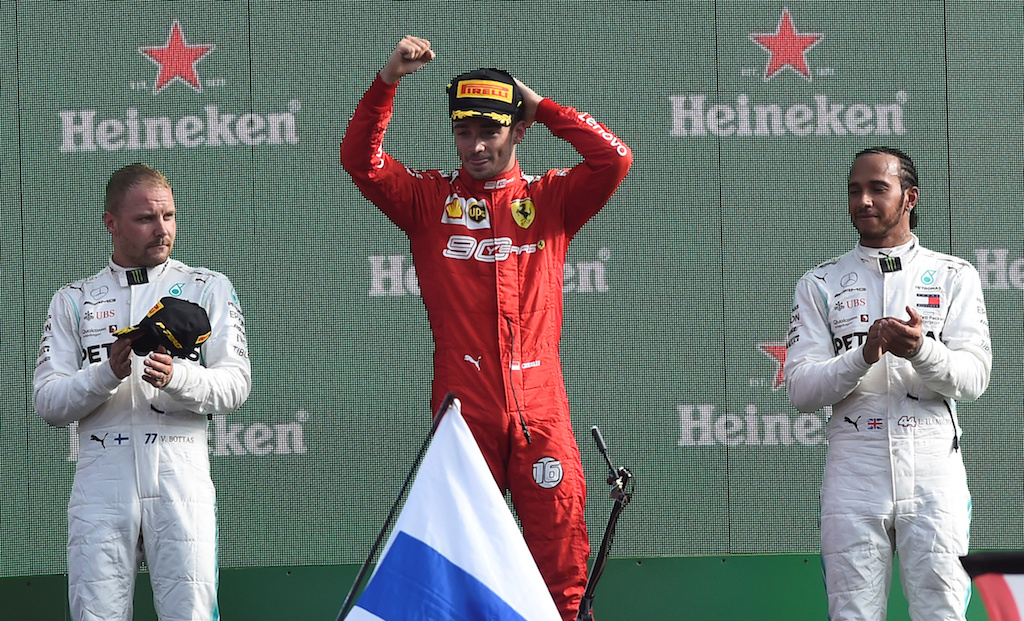 Ferrari's Charles Leclerc celebrates winning the race with second place Mercedes' Valtteri Bottas and third place Mercedes' Lewis Hamilton.