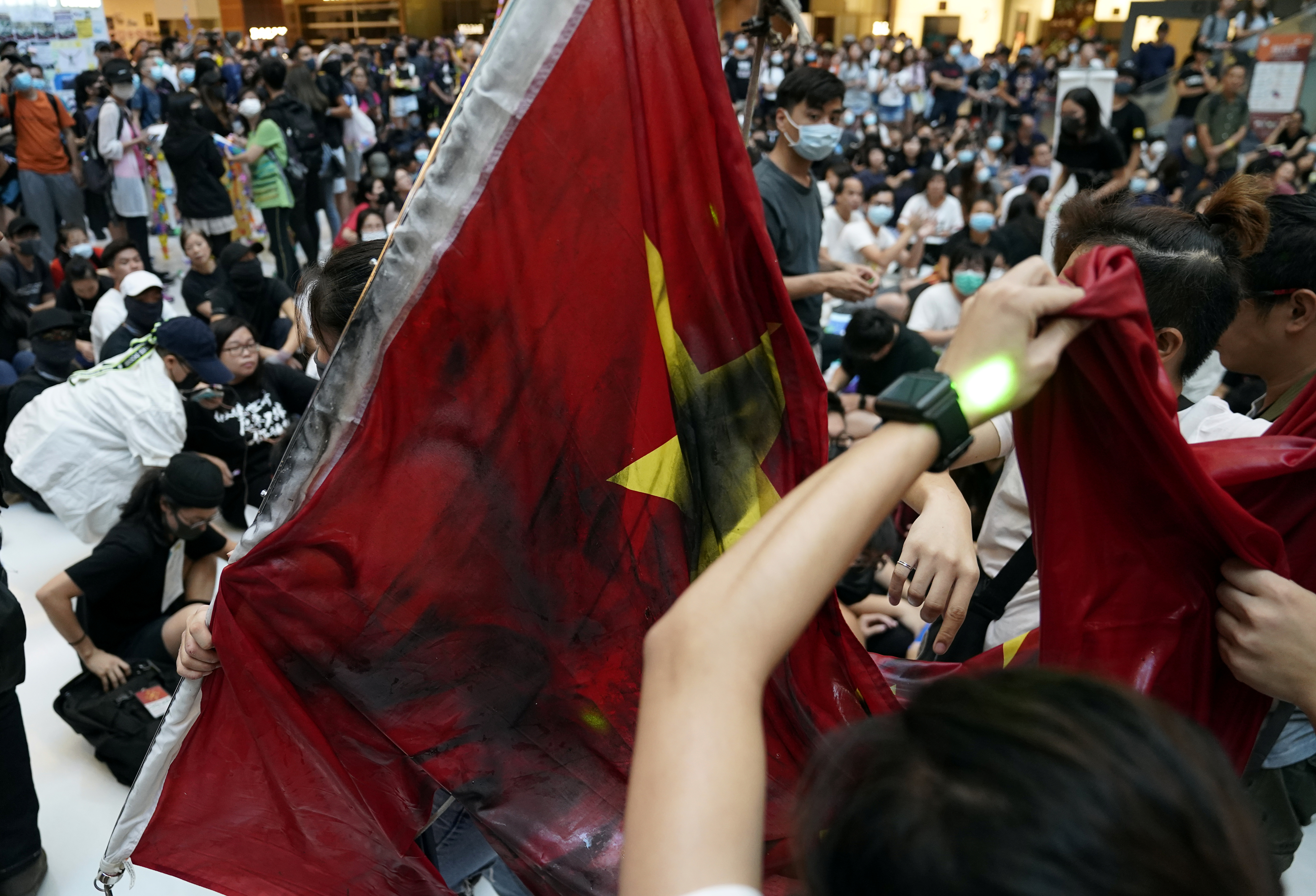 Anti-government protesters destroy a Chinese flag during a rally in a shopping mall in Sha Tin, Hong Kong, China September 22, 2019.