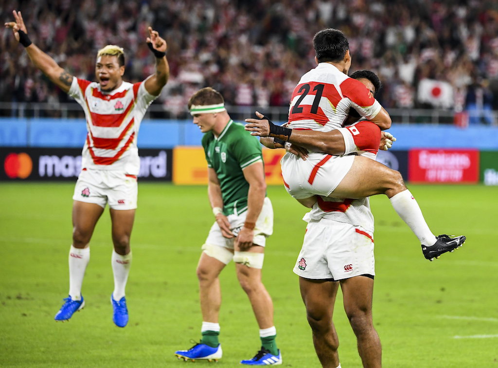 Japan players celebrate victory at the end of the Japan 2019 Rugby World Cup Pool A match between Japan and Ireland at the Shizuoka Stadium Ecopa in Shizuoka on September 28, 2019.