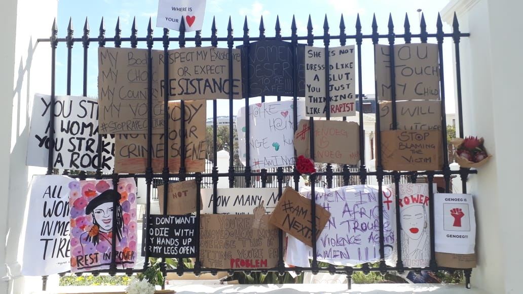 Protesters against rape and femicide display signs outside parliament 5 September 2019