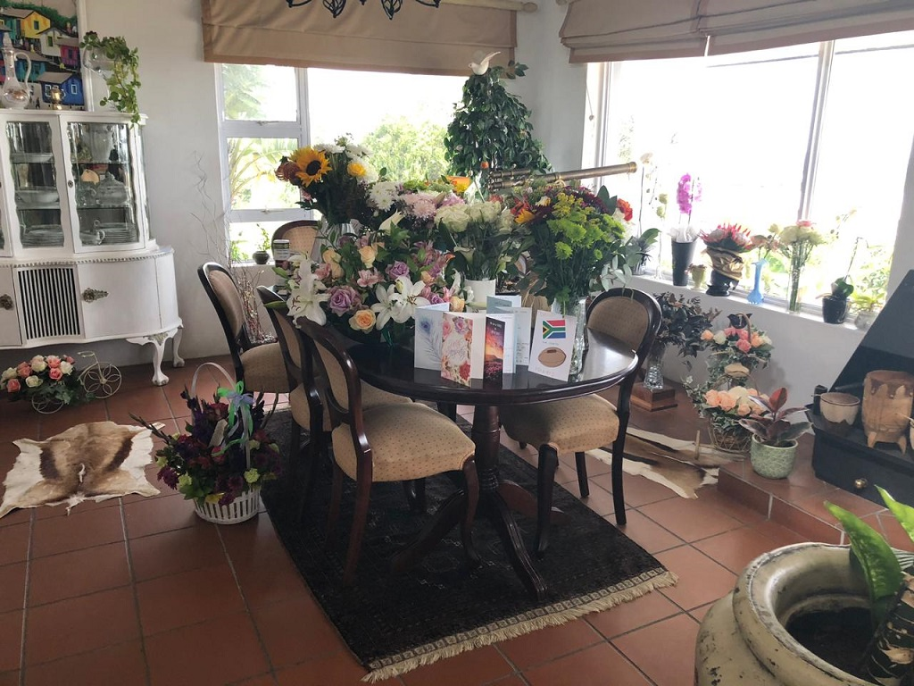 Flowers and cards fill the Williams home after Chester Williams death