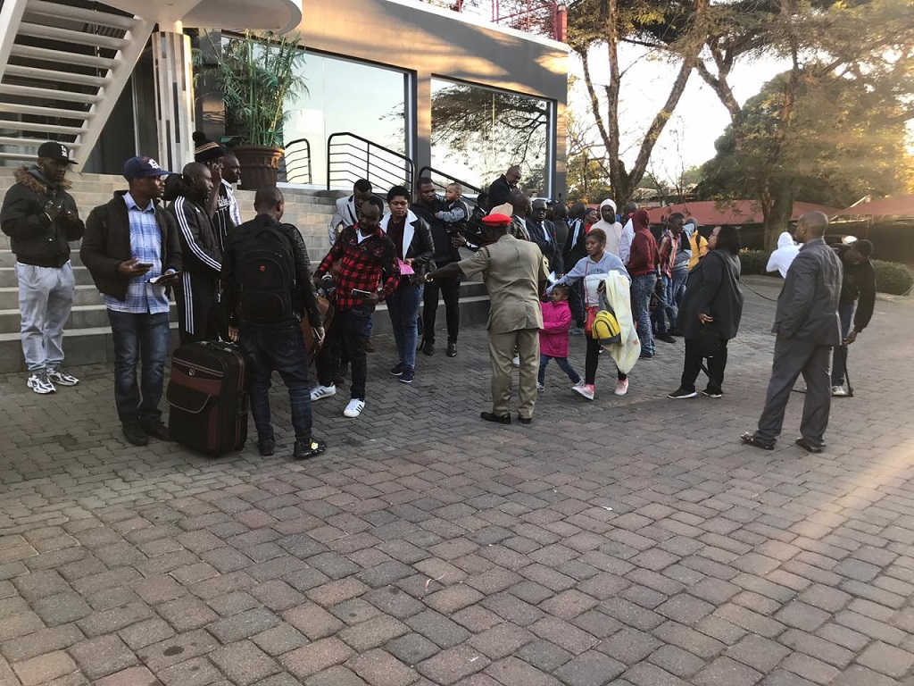 Foreign nationals outside the Nigerian consulate as they prepare to leave South Africa