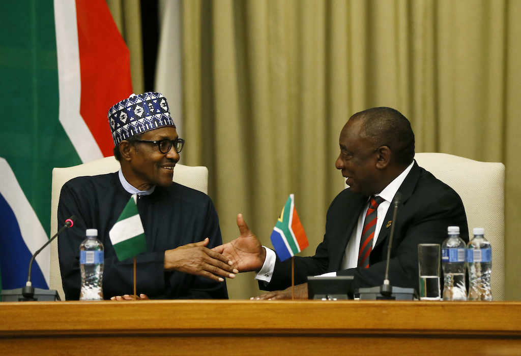 Nigeria's President Muhammadu Buhari (L) and South Africa's President Cyril Ramaphosa shake hands following their opening remarks during his official state visit at Union Buildings in Pretoria, on October 3, 2019.