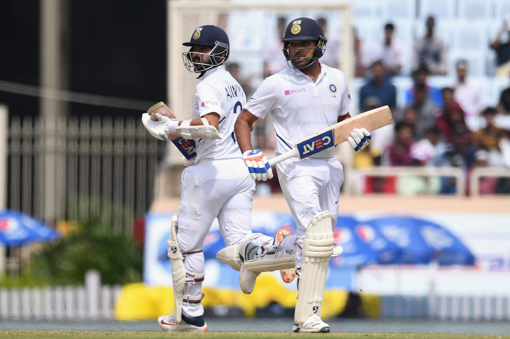 Ajinkya Rahane (L) and teammate Rohit Sharma (R) run between the wickets during the first day of the third and final Test match between India and South Africa at the Jharkhand State Cricket Association (JSCA) stadium in Ranchi on October 19, 2019.