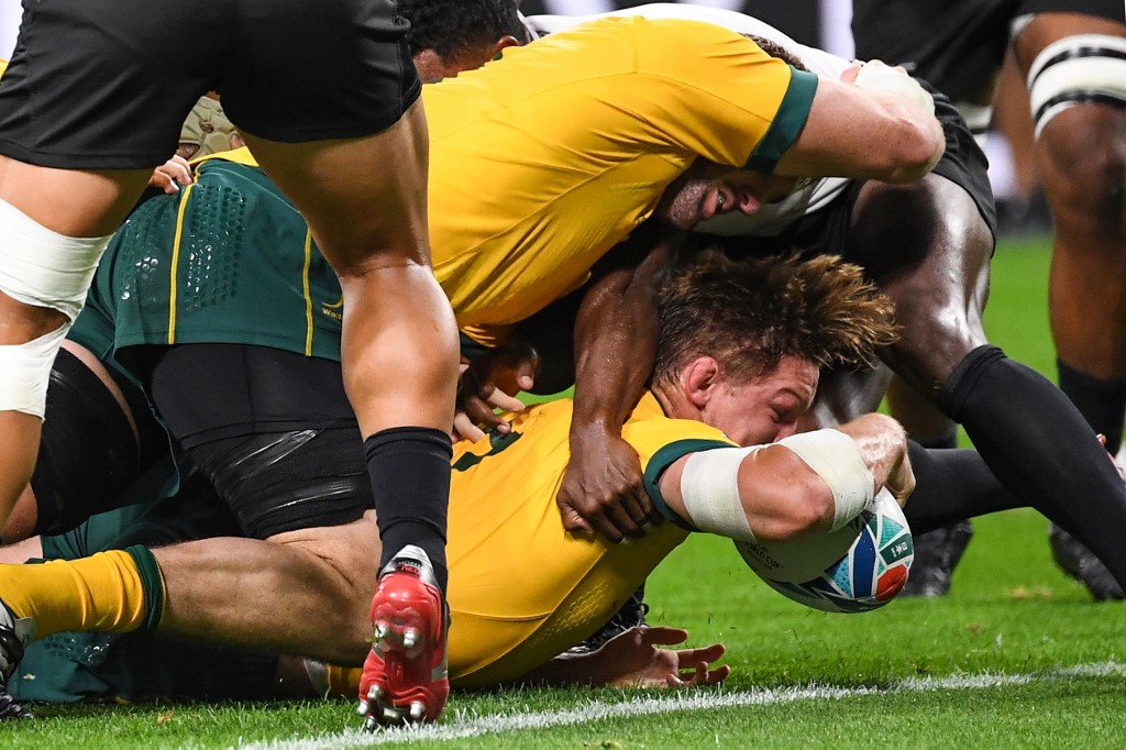 Australia's flanker Michael Hooper scores a try during the Japan 2019 Rugby World Cup Pool D match between Australia and Fiji at the Sapporo Dome in Sapporo on September 21, 2019.