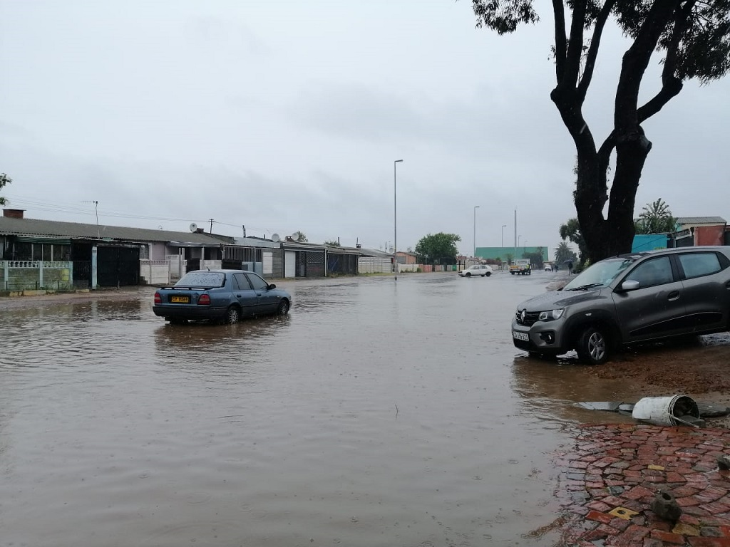 Broken down car in flood waters in Bonteheuwel
