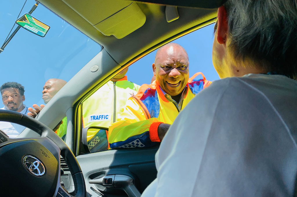 President Cyril Ramaphosa interacts with motorists during the launch of  October Transport Month.