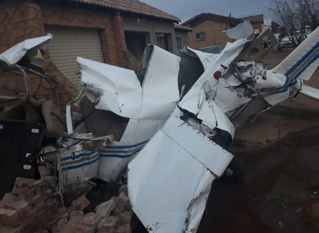 The light Piper aircraft crashed between two houses after hitting the garage wall of one of the houses at Isaac Peloeng Street.