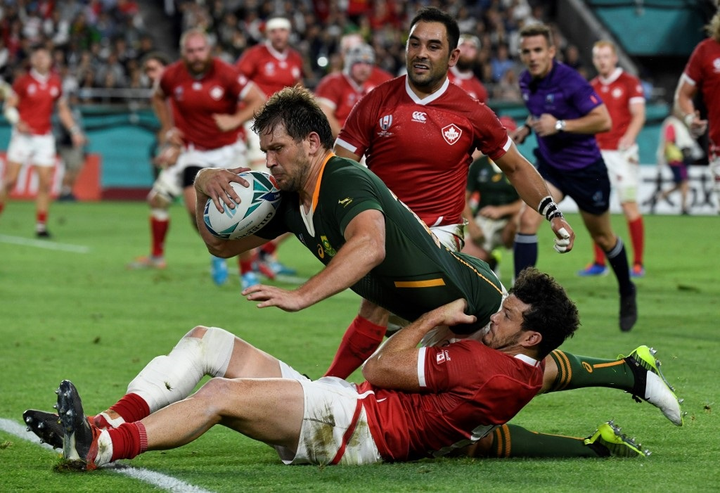 Springboks Frans Steyn Canada's Ciaran Hearn and Phil Mack (up) during the Japan 2019 Rugby World Cup