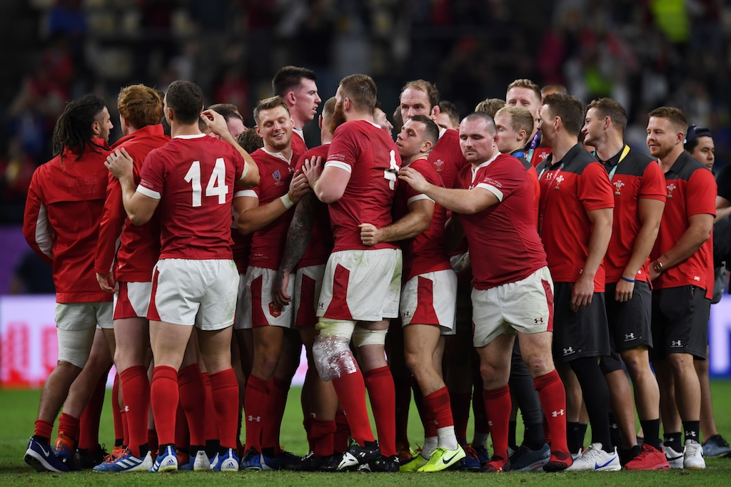 Wales' players celebrate after winning the Japan 2019 Rugby World Cup quarter-final match between Wales and France at the Oita Stadium in Oita on October 20, 2019.