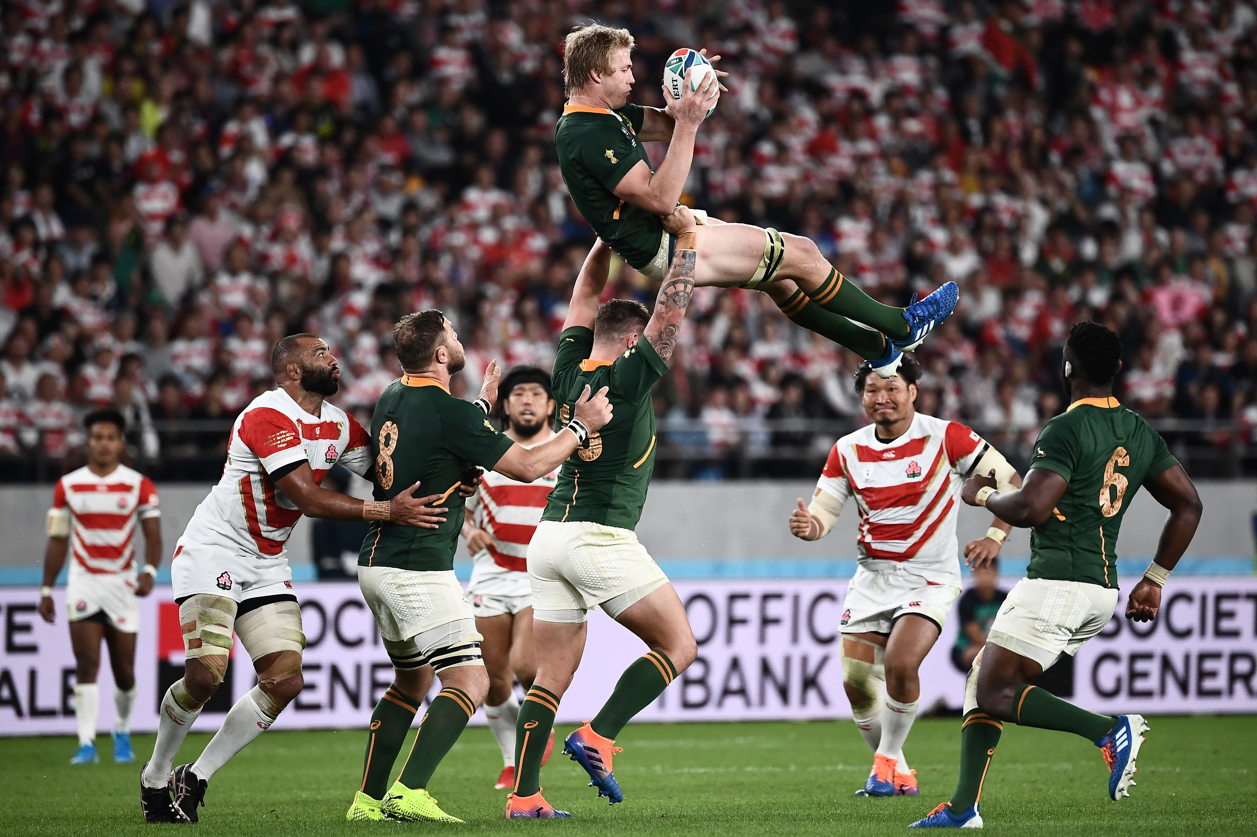 South Africa's flanker Pieter-Steph Du Toit (up) is lifted to catch the ball during the Japan 2019 Rugby World Cup quarter-final match between Japan and South Africa.