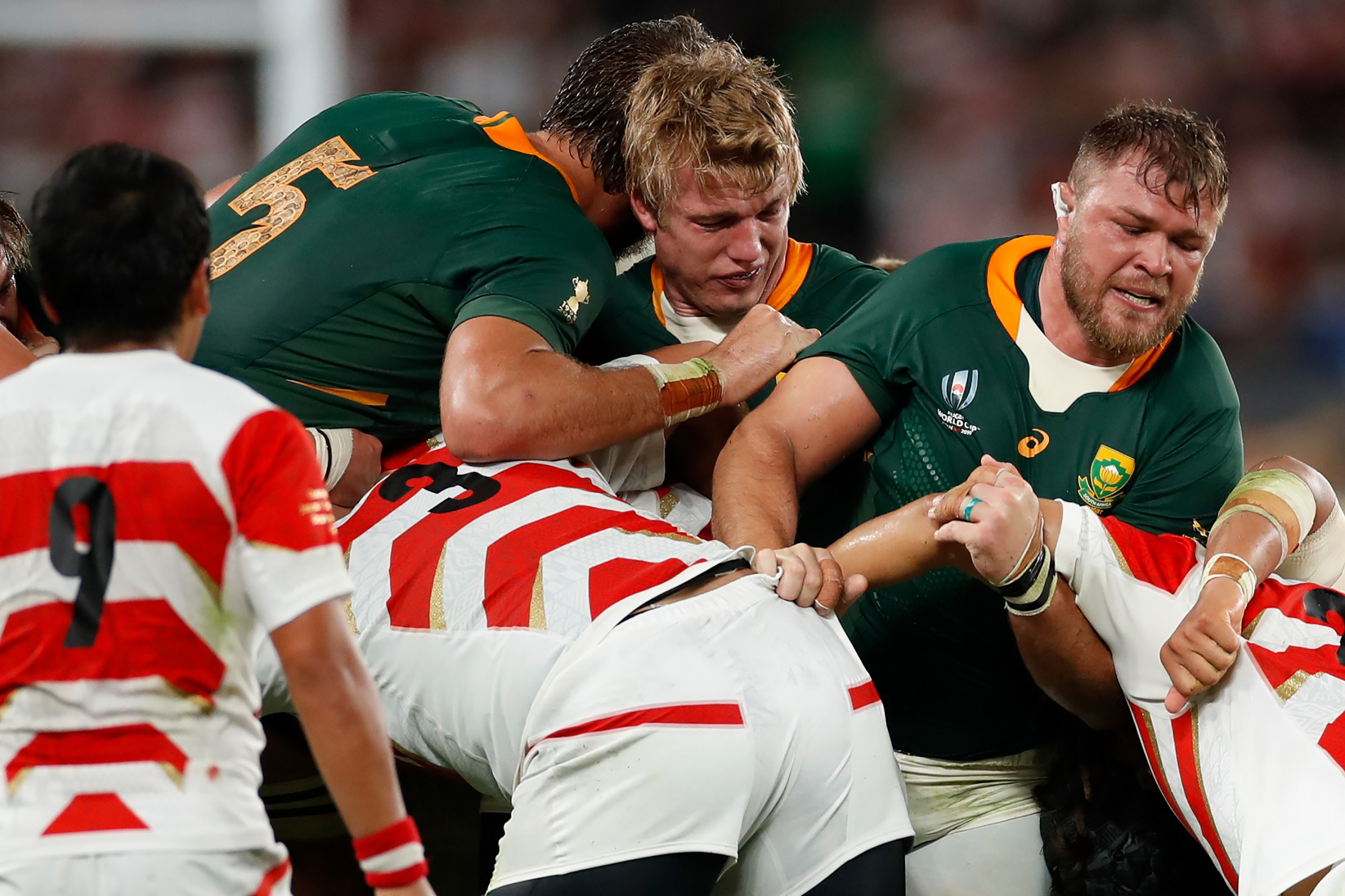 Duane Vermeulen (R), South Africa's flanker Pieter-Steph Du Toit (C) and South Africa's lock Lood De Jager (top L) are defended during the Japan 2019 Rugby World Cup quarter-final match between Japan and South Africa.