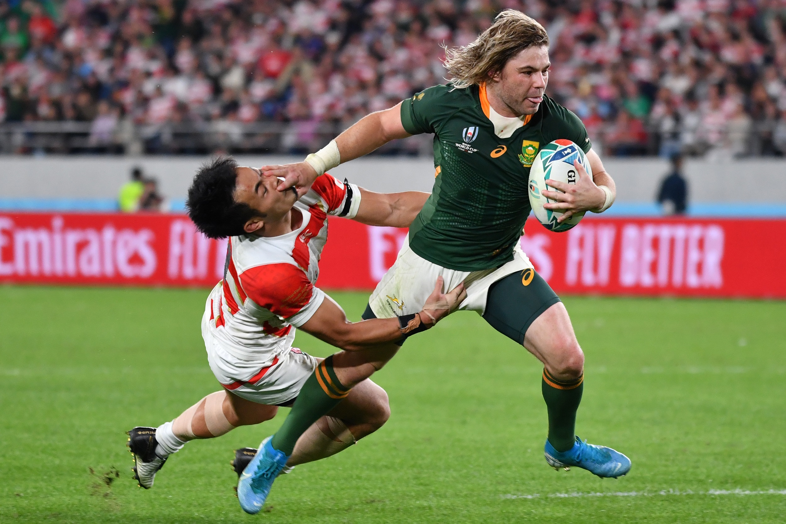 Scrum-half Faf de Klerk (R) scores a try during the Japan 2019 Rugby World Cup quarter-final match between Japan and South Africa.