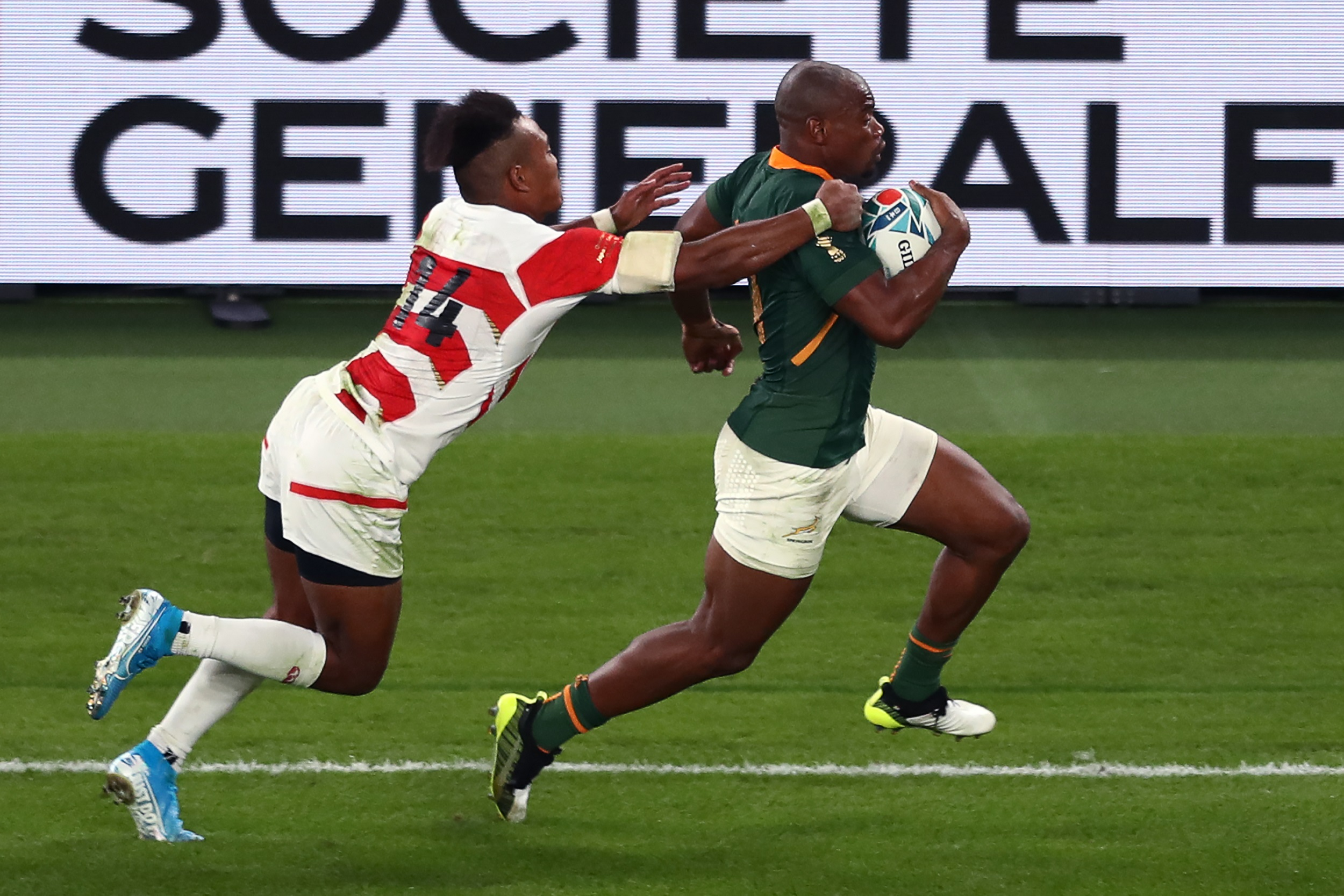 Makazole Mapimpi (R) runs to score a try during the Japan 2019 Rugby World Cup quarter-final match between Japan and South Africa.