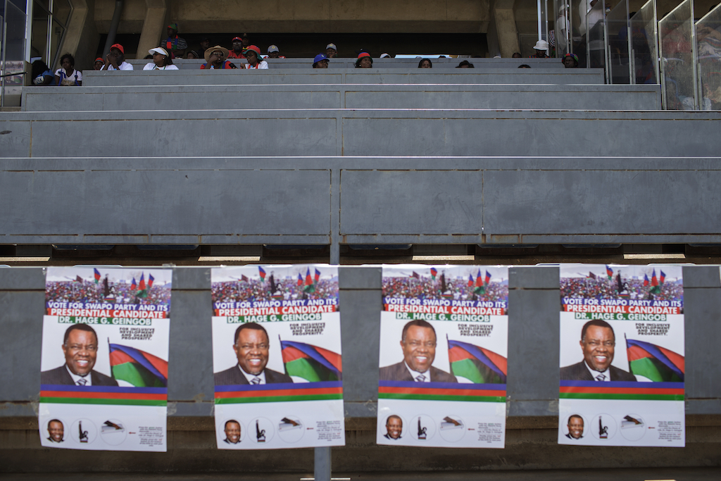Electoral posters of the Namibian incumbent president and ruling party South West Africa People's Organisation (SWAPO) presidential candidate Hage Geingob are seen in the tribunes as his supporters attend the final Namibian General elections SWAPO campaign rally on November 23, 2019 in Windhoek, Namibia.