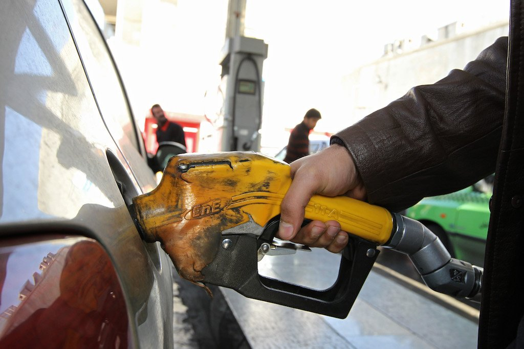 An Iranian man pumps gasoline into his car at a petrol station in Tehran on December 19, 2010.