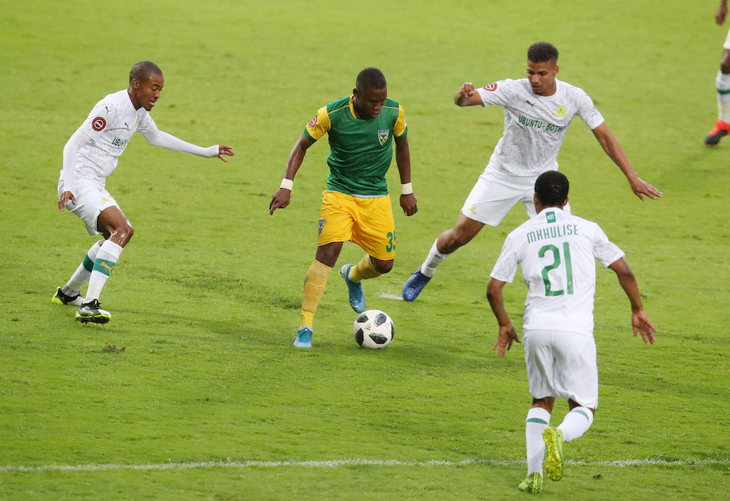 Lindokuhle Mtshali of Golden Arrows challenged by Rivaldo Coetzee, Thapelo Morena and Sphelele Mkhulise of Mamelodi Sundowns during the Absa Premiership 2019/20 match between Golden Arrows and Mamelodi Sundowns at the Sugar Ray Xulu Stadium, Clermont on the 10 November 2019.