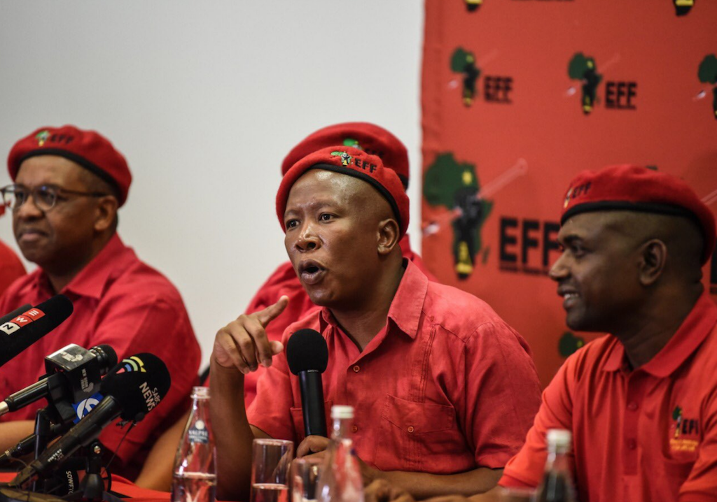 EFF leader Julius Malema (C), national chair Dali Mpofu (L), secretary-general, Godrich Gardee (R) at the party's conference in Johannesburg.