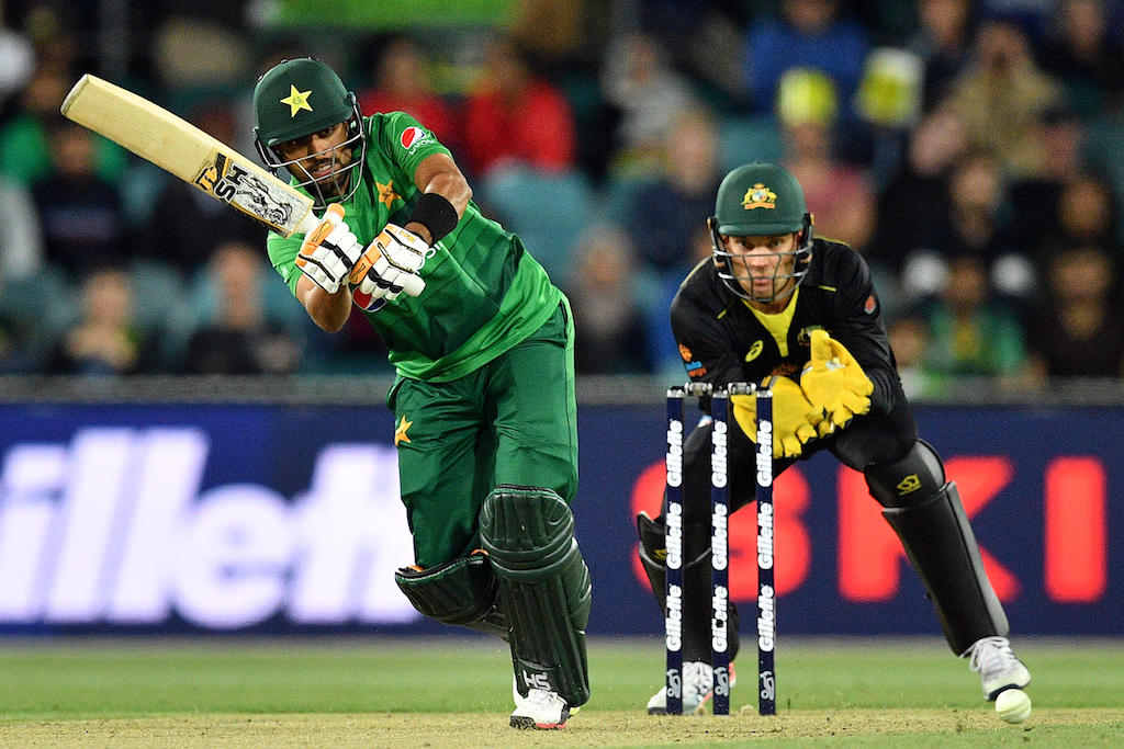 Pakistan's Babar Azam plays a shot as Australia's wicketkeeper Alex Carey (R) looks on during the second Twenty20 match.