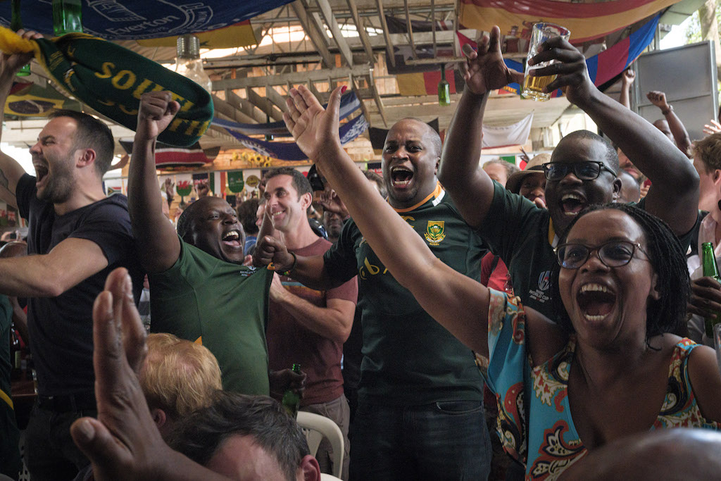 Fans react as they watch the Rugby World Cup 2019 final between South Africa and England.