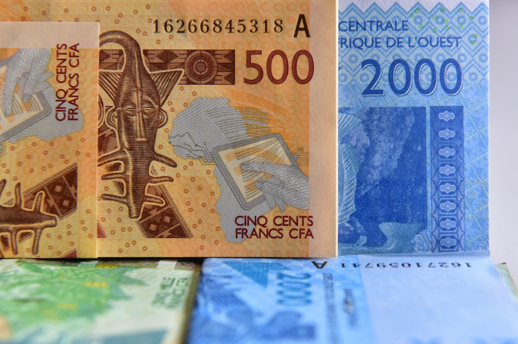 File: Eight countries use the euro-pegged West African CFA franc, which enjoys unlimited convertibility with the euro.