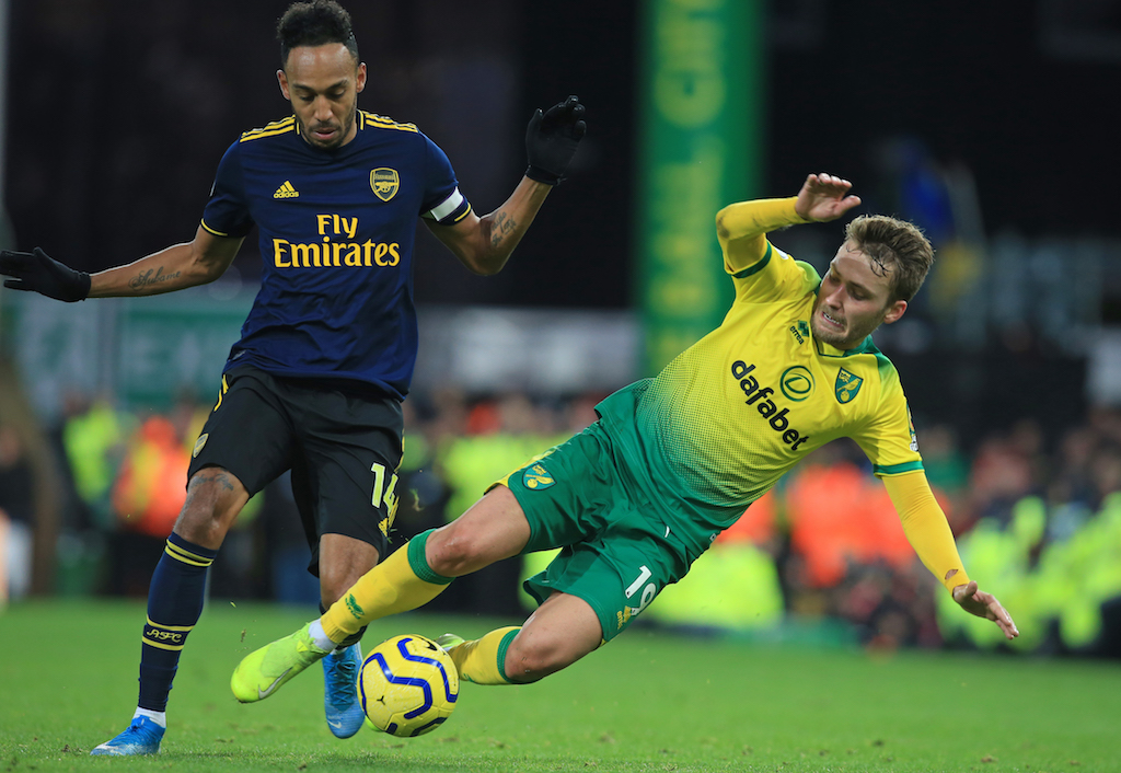 Arsenal striker Pierre-Emerick Aubameyang (L) vies with Norwich City midfielder Tom Trybull (R) during the English Premier League football match at Carrow Road in Norwich on 1 December 2019.