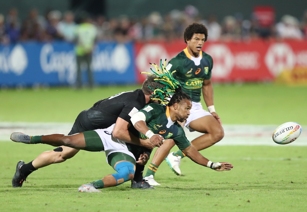 Rosko Specman (R) of South Africa is tackled by Kurt Baker (L) of New Zealand during the HSBC World Rugby Sevens Series men final match between New Zealand vs South Africa in Dubai, United Arab Emirates, 07 December 2019.