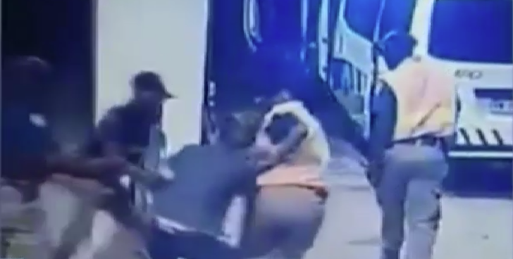 File: In the CCTV video, the woman is being pulled and dragged by officers at a petrol station in Lyttleton, Pretoria.