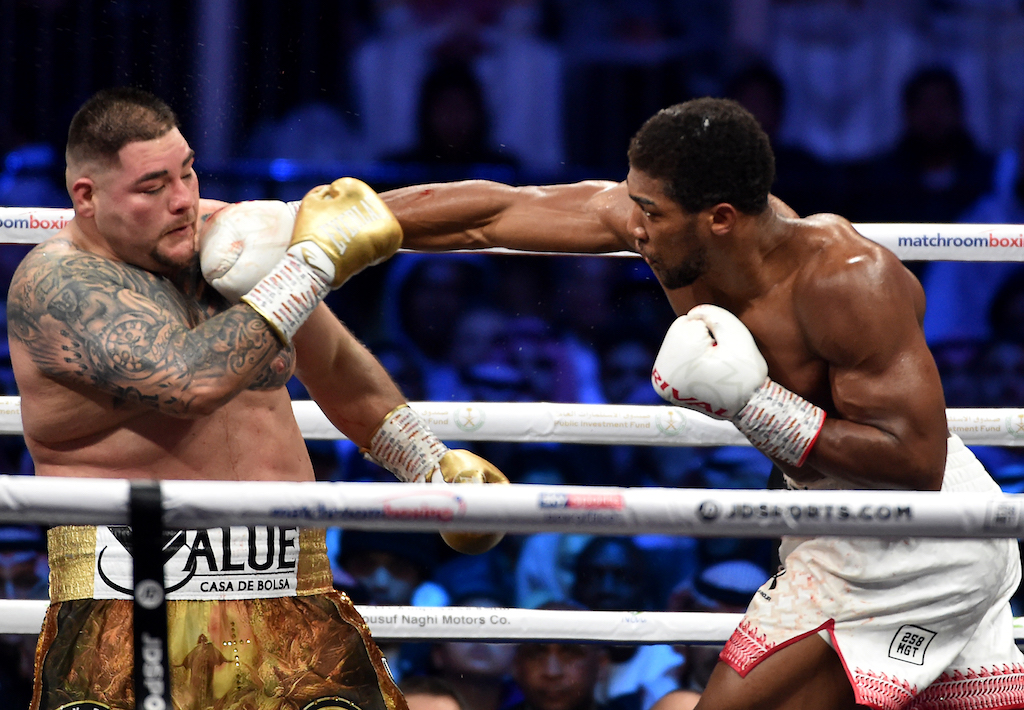 British boxer Anthony Joshua (white trunks) competes with Mexican-American boxer Andy Ruiz Jr (golden trunks) during the heavyweight boxing match for the IBF, WBA, WBO and IBO titles.