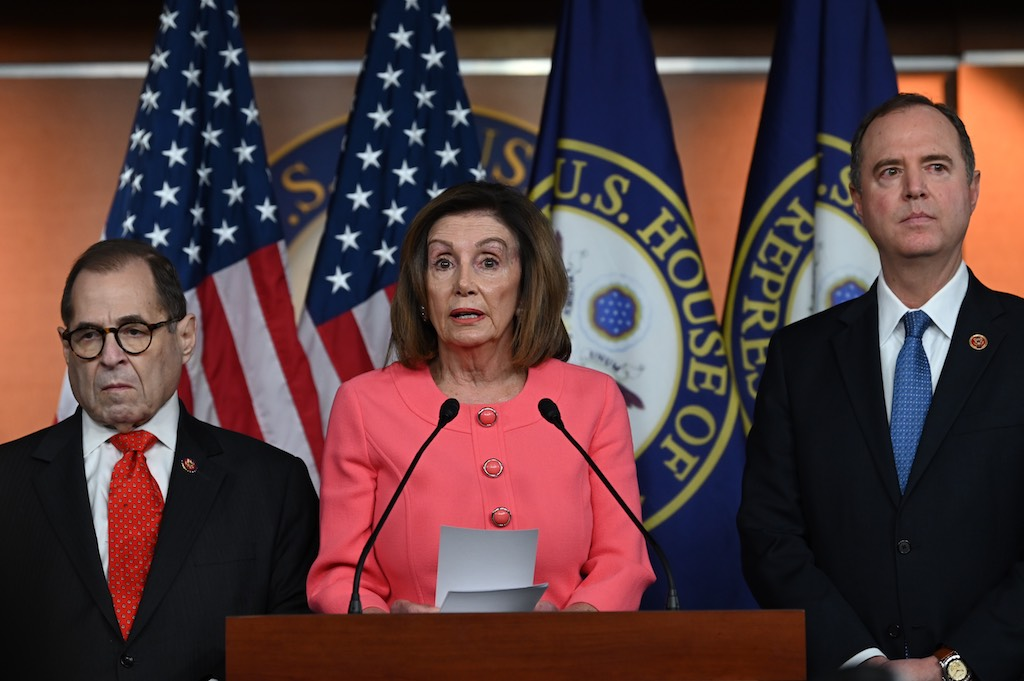 Speaker of the House Nancy Pelosi (D-CA) announces impeachment managers for the articles of impeachment against US President Donald Trump on Capitol Hill January 15, 2020, in Washington, DC, next to Judiciary Committee Chairman Jerry Nadler(L)D-NY and Adam Schiff(D-CA), the House Democrat who led the Trump investigation.