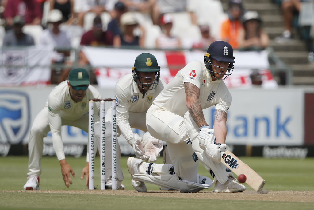 England's Ben Stokes (R) plays a shot as South Africa's Quinton de Kock (C) and South Africa's captain Faf du Plessis (L) look on.