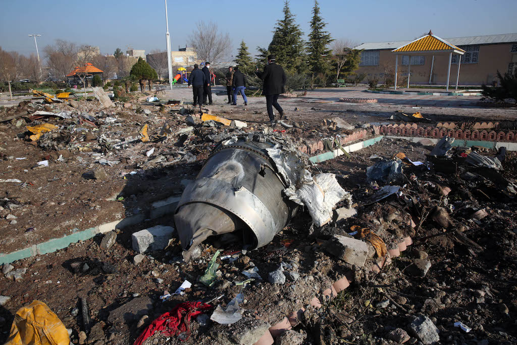 Rescue teams work amidst debris after a Ukrainian plane carrying 176 passengers crashed near Imam Khomeini airport in the Iranian capital Tehran.