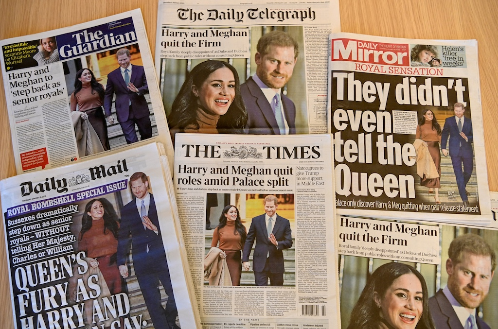 "An arrangement of UK daily newspapers shows front page headlines reporting on the news that Britain's Prince Harry and his wife Meghan plan to step back as ""senior"" members of the Royal Family."