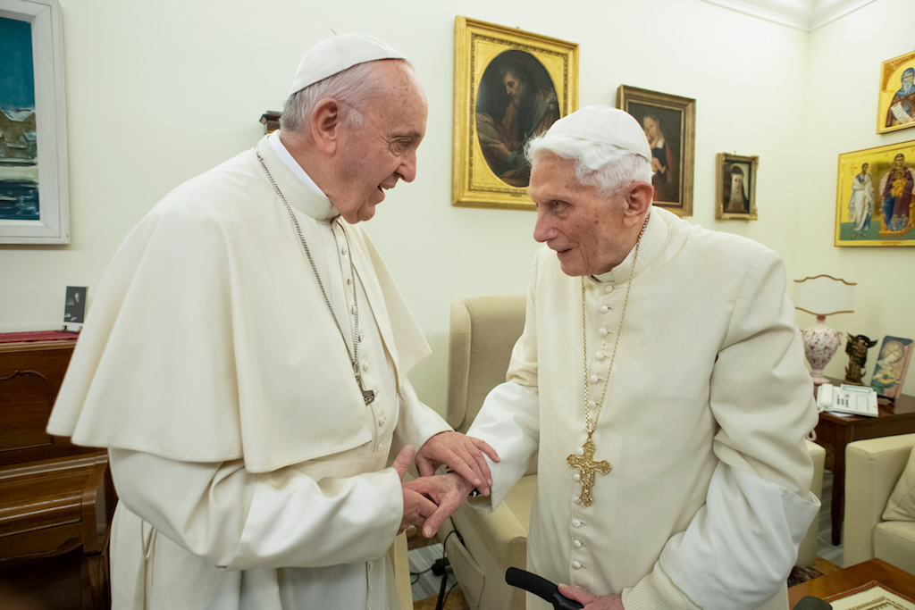 File: Pope Francis (L) meeting with Pope Benedict XVI (R) at the Vatican. Benedict has publicly urged his successor not to open the Catholic priesthood up to married men.