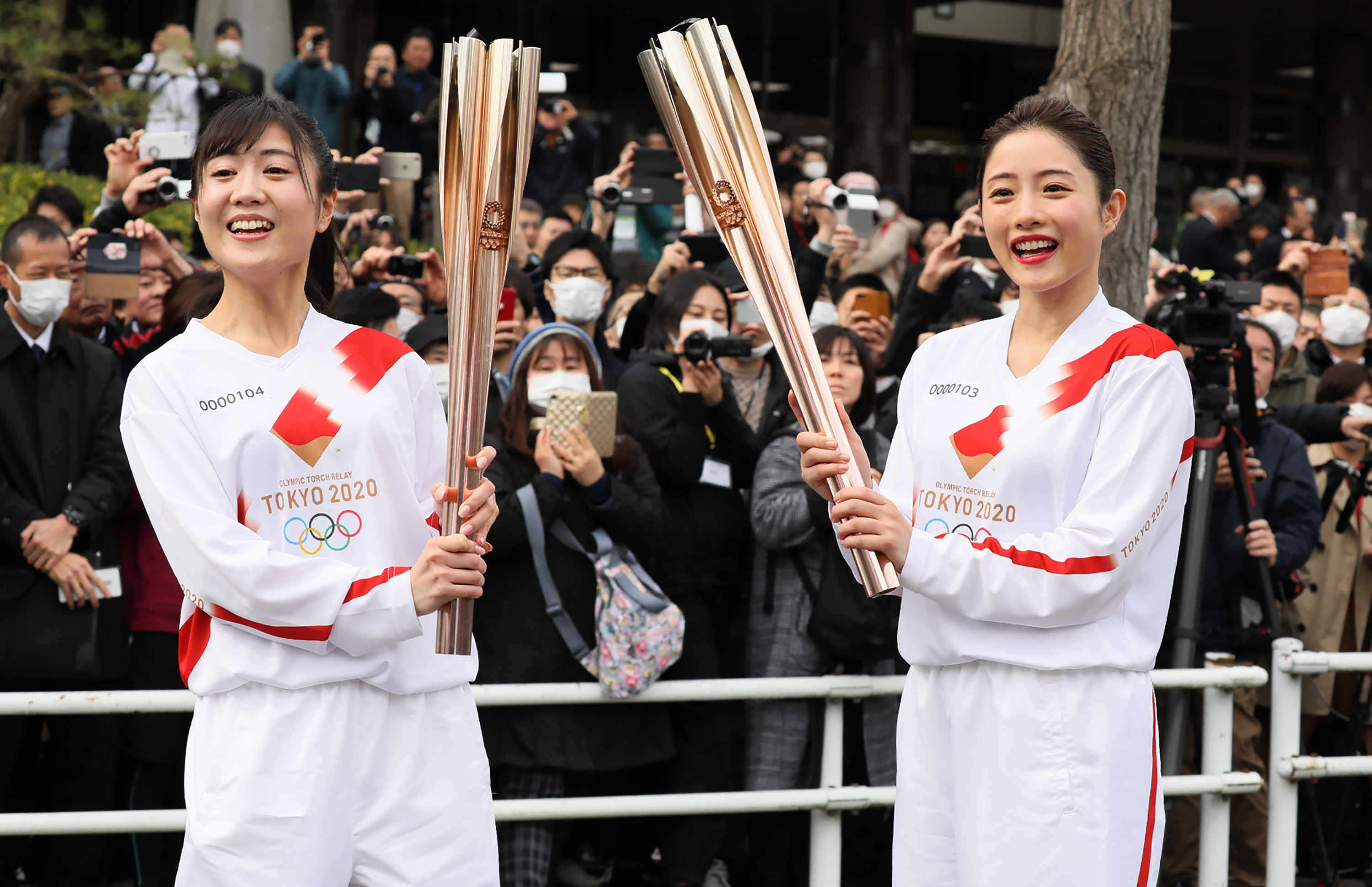 File: A torchbearer and actress Satomi Ishihara (R), one of the official ambassadors of the Tokyo 2020 torch relay, pose with the olympic torch during a rehearsal of the Tokyo 2020 Olympics torch relay in Tokyo on February 15, 2020.
