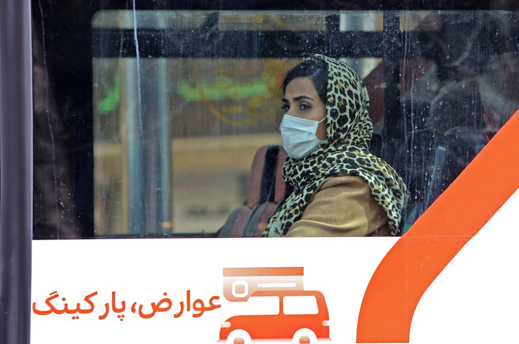 A woman wears a protective mask while riding a bus in the Iranian capital Tehran.