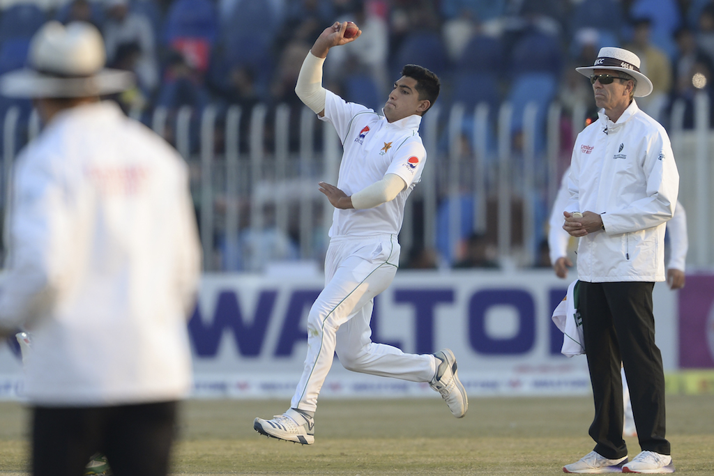 Pakistan's Naseem Shah delivers the ball during the third day of the first cricket Test match between Pakistan and Bangladesh.