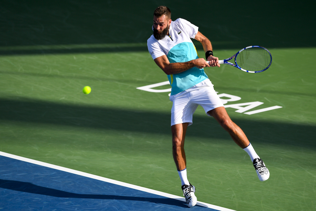 France's Benoit Paire returns the ball to Croatia's Marin Cilic during the round of 32 in the Dubai Duty Free Tennis Championships.