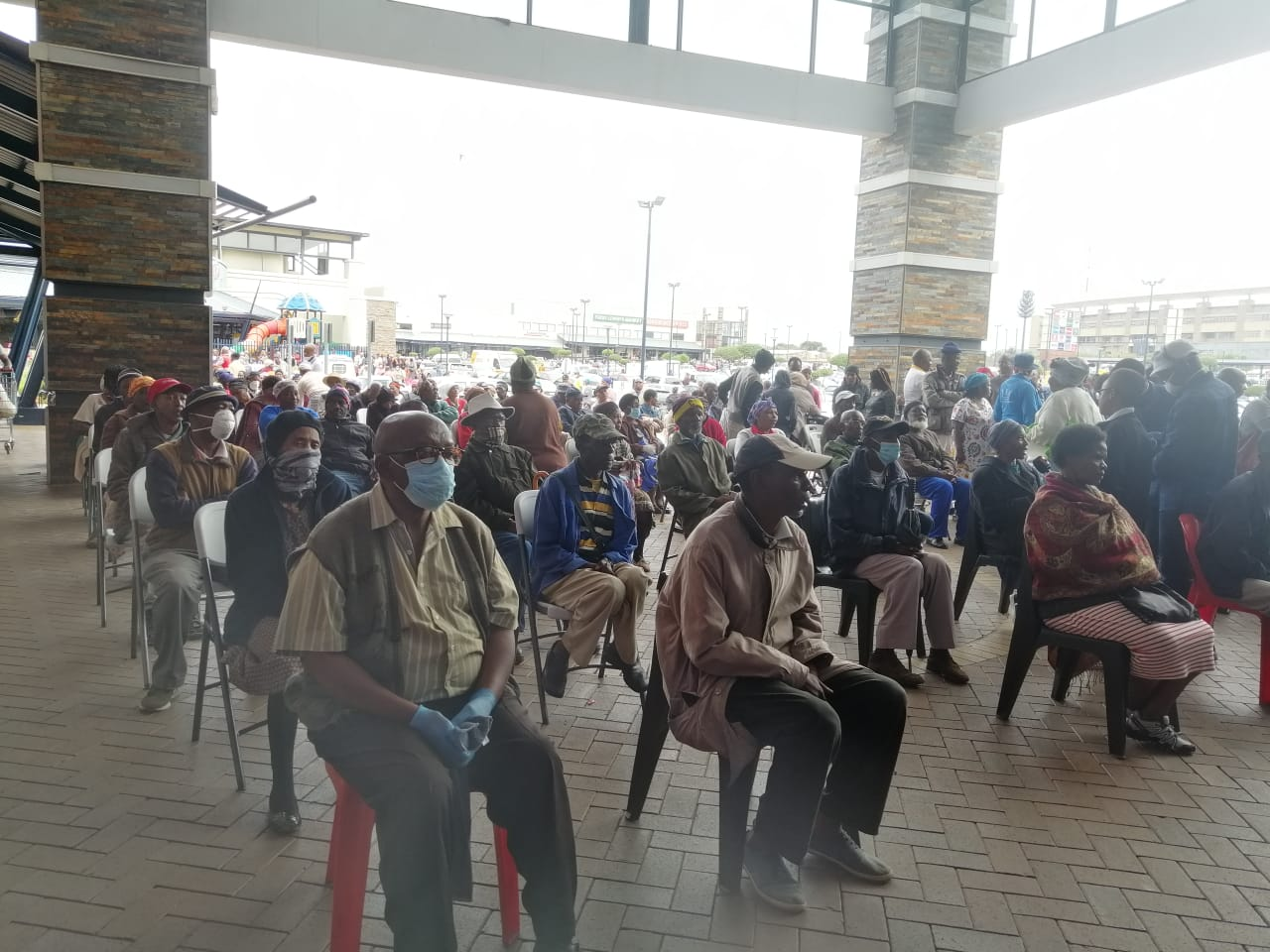 Pensioners and people with disabilities waiting for Sassa payouts at Jabulani Mall.