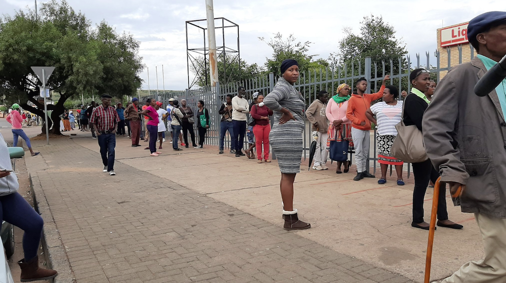 People queueing to receive Sassa social grants.